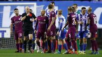 Manchester City and Wigan Athletic charged by FA for failing to control players