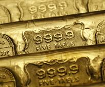 Gold near 7-week low as safe-haven demand fades after French election