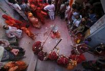 Holi 2013: Spectacular Images of Lathmar Holi Celebrated in Mathura, Vrindavan [PHOTOS]