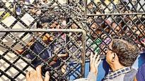 Cash crunch: Failing to get money from bank, people block Amritsar-Attari road