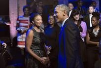 Reluctant Obama leads town hall on race, policing amid 'deep divisions'