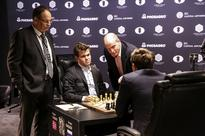 Magnus Carlsen starts the World Chess Championship with a bang — but game 1 ends with a draw