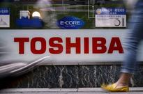 Toshiba mulls chips business stake sale to Western Digital