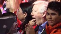 Bob Rae apologizes for making gag gesture when Trudeau praises Harper