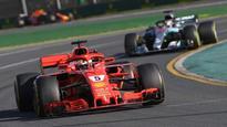 Australian GP: Opportunistic Sebastian Vettel steals victory from Lewis Hamilton
