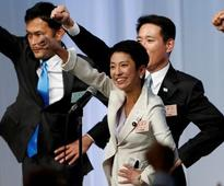 Japan opposition party picks first female leader after citizenship hiccup