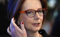 Gillard urges Americans to call out sexism