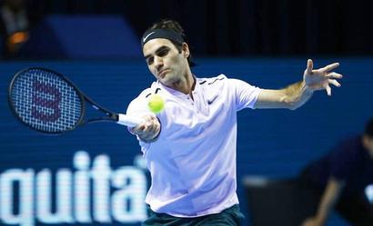 Razor-sharp Federer races through in Basel