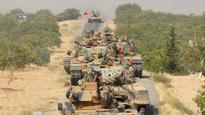 Turkey ratchets up Syria offensive, says warplanes hit Kurdish militia