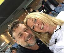 Is Russell Crowe in love with Julie Burgess? Actor and rugby mum 'canoodling' at Ed Sheeran concert