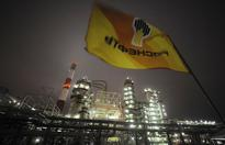 Analysts say oil rally is not just about hedge... A flag with the logo of Rosneft Russias largest oil company flutters over th...