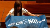 New pro-democracy lawmakers in Hong Kong flaunt opposition to Chinese rule