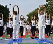 Thousands participate in Yoga Day event at Connaught Place
