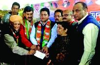 MP presents cheques to 106 beneficiaries