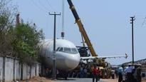 Air India plane falls to ground after crane carrying it collapses
