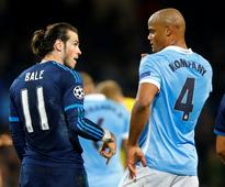 Without Ronaldo, Madrid holds City 0-0 in Cham... Real Madrid's Gareth Bale speaks with Manchester City's Vincent Komp...