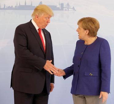 Trump shakes hands with Merkel