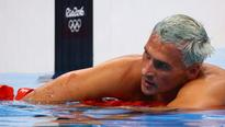 Four American swimmers robbed at gunpoint in Rio, U.S. Olympic Committee says