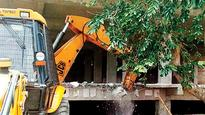 Akhilesh minister's illegal commercial building razed