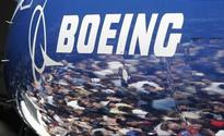 Boeing says it will cut commercial airplane jobs to reduce costs