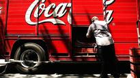 Coca-Cola to report third-quarter earnings before the bell. Here's what Wall Street expects