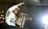 Hamilton takes Formula One title, Mercedes wary of Ferrari pace