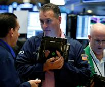 Wall Street higher as data points to strengthening economy