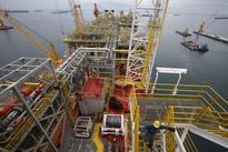Oil down 4 percent as U.S. glut overshadows producer talks