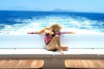 Geri Halliwell recreates Mi Chico Latino pose as she strips to skimpy bikini 17 years later