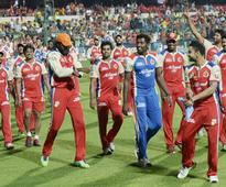 Kohli, Zaheer star for RCB