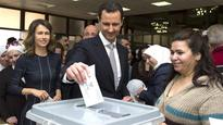 Assad asks electricity minister to form new government