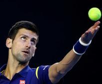 The Latest: Djokovic wins 1st set 6-1 vs Murray in final