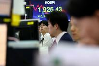 Seoul shares open higher on securities gains