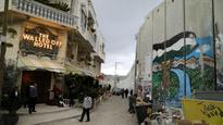 'Hotel With The Worst View': British graffiti artist Banksy opens The Walled Off Hotel next to Israel-Palestine Barrier