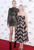 Little and large: Naomi Watts is swamped by Karolina Kurkova at Cannes Film Festival