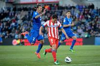 Nine-man Atletico held to draw at Getafe
