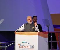 Corporates look past India's cash crisis, praise Modi reforms