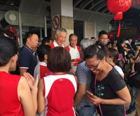 PM Lee hands out red packets to needy elderly in Teck Ghee