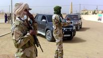 Top jihadist suspect arrested in southern Mali... Soldiers of the Coordination of Movements of the Azawad stand guard as they ...