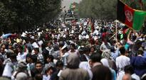 Thousands of people from Afghanistan's Hazara minority had gathered to demand changes to the route of a planned multi-million dollar power transmission line. Islamic State has claimed responsibility for the attack, says the group's Amaq News Agency.