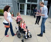 Football star Peter Crouch helps fundraiser for little girl to walk