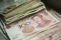 China urges calm on yuan after US rate hike