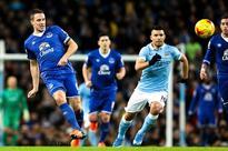 Everton's Phil Jagielka calls referee Martin Atkinson