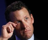 Armstrong quits swimming event