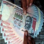 Rupee opens marginally lower at 67.17 per dollar
