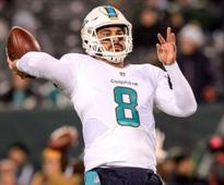 Moore throws career-high 4 TDs as Dolphins rout Jets
