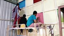 Deaf Bengaluru artists take dull HIV walls down