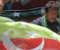 Imran Khan's party wins revote in Karachi, protests expected