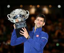 Don't want a 'big slap from karma': Australian Open champ Djokovic stays grounded after record