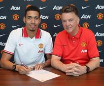 Man United defender Chris Smalling signs a new contract to extend his deal until 2019